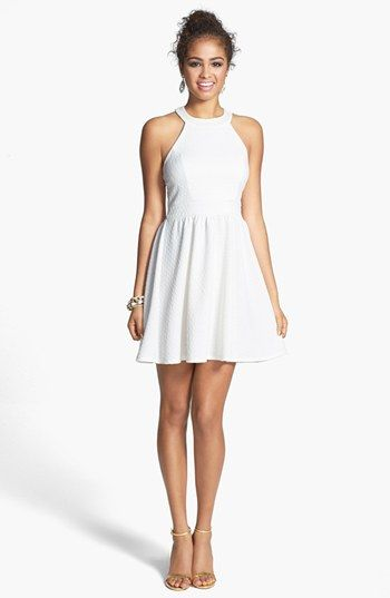 This says Ivory, but looks pretty white to me. Bailey Blue Bow Back Textured Skater Dress (Juniors) | Nordstrom