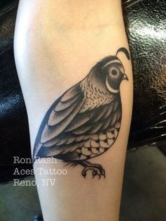 Cute little black and white quail bird tattoo