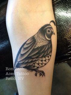 Cute little black and white quail bird tattoo