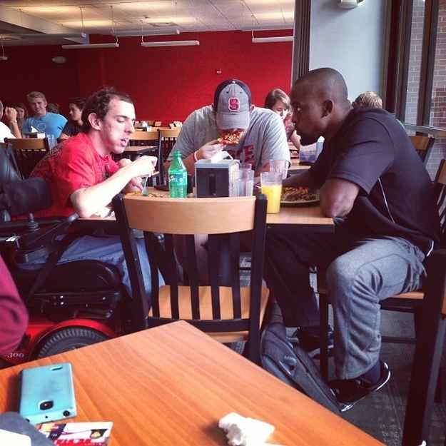 This picture of two football players who didn't want this student to eat alone. | 35 Pictures That Prove The World Isn't Such A Bad Place