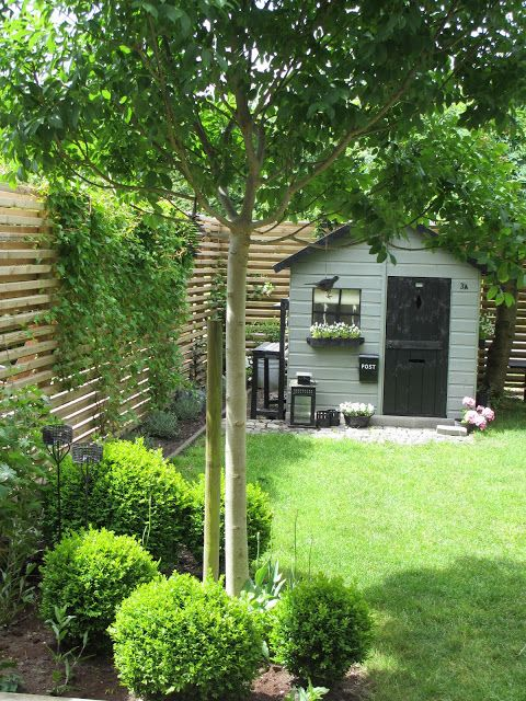Simple yet beautiful garden setting surrounding this cute garden shed/kids cubby house