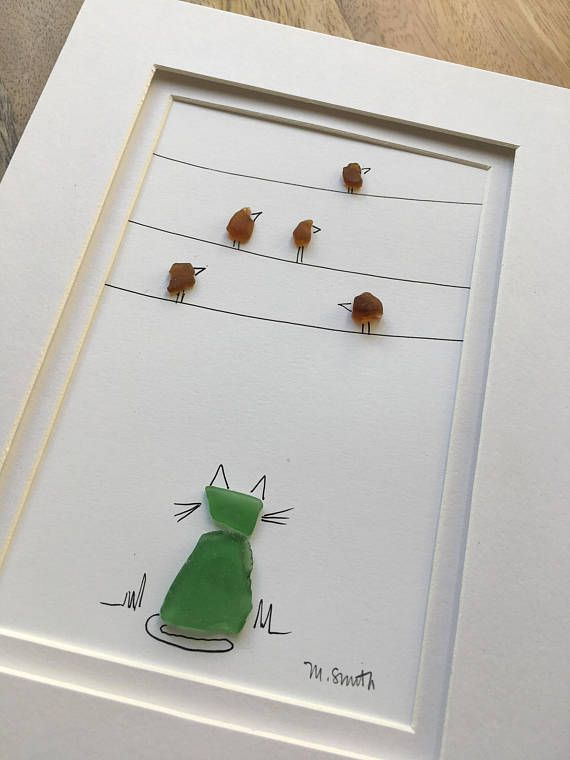 Sea Glass from the shores of New England are used in combination with hand drawn ink to create a whimsical piece of one of a kind art. Perfect for your cat lover, a whimsical way to express your love for your feline friend.  Art is 4x6, double matted and framed [overall dimensions