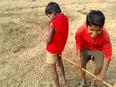 Funny Gifs ~ boy peeing as friend uses stick to pump his butt like a water pump