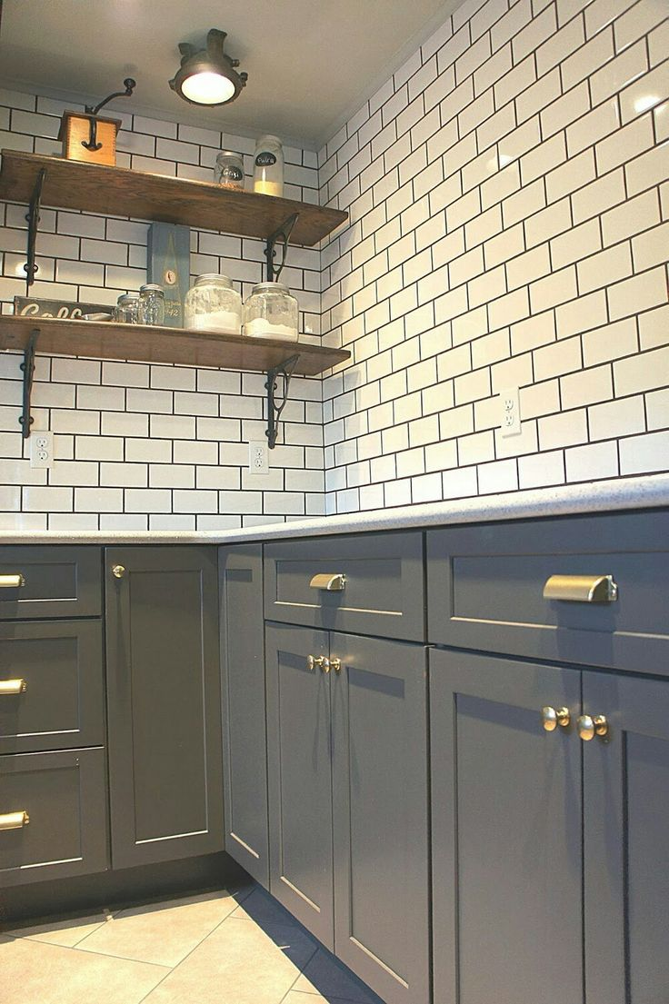 Unfinished kitchen cabinets in ct - Chic Design Investments Brown Kitchen Cabinets With Brass Subway Tile And Exposed Shelving
