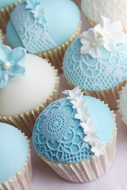 Tiffany blue lacey perfectly round, wedding  cupcakes:)