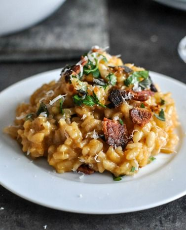Roasted Sweet Potato Risotto. Beautiful winter recipe. Hold the butter, add ham or chicken cubes instead of bacon, and go heavy handed on the herbs - that's my style.