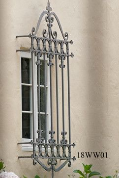 Custom Iron Window Grilles. A box style so you can open a casement window.
