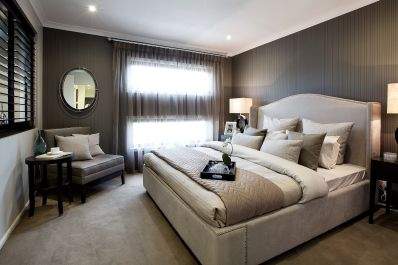 This Manhattan Style Master Bedroom Is Decorated With Moody Tones Of Taupe And Chocolate Featuring A Studded Bed Frame Chrome Decor Items Cla
