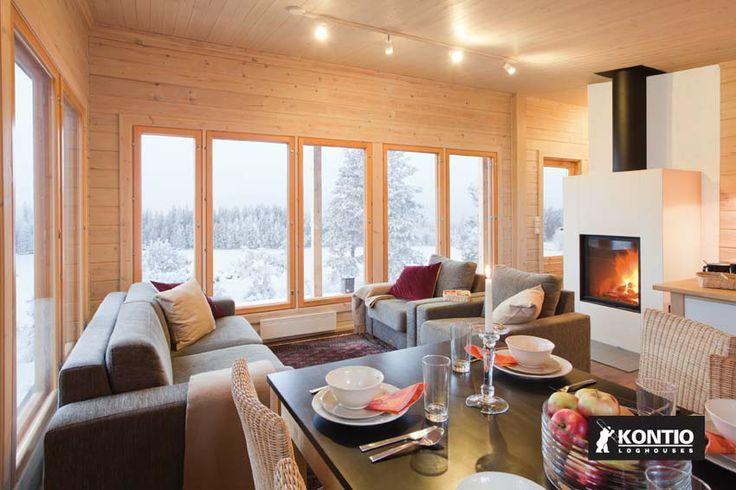 Feu de cheminée pour les journées froides d'hiver dans une maison en bois Kontio.  http://www.kontio.fr/