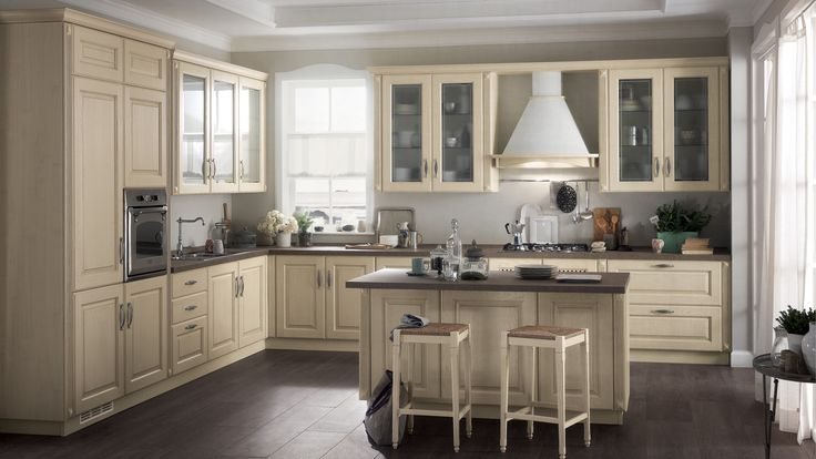 Madeleine Kitchen - design by Vuesse. Ample use of wood and lovingly finished details make Madeleine a return to the pleasure of an Italian tradition, offering an authenticity that never fails to charm and delight.