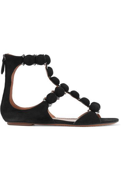 Alaïa's sandals are punctuated with gunmetal pyramid studs and button-like straps that have each been covered and applied by hand – a brand signature. Made in Italy from black suede, this pair is backed in smooth leather and has a comfortable cushioned insole.