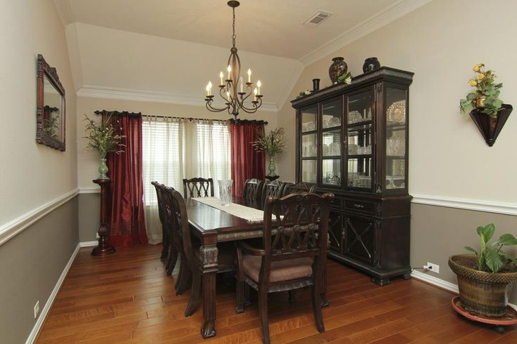 formal dining room 15 x 11 elegant entertaining is achieved in the stylish dining room with vaulted ceiling chandelier crown moulding chair - Dining Room Two Tone Paint Ideas