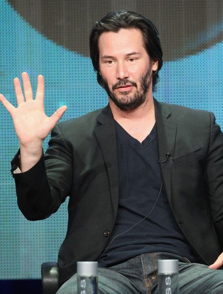 """Keanu Reeves Photos Photos - Host/producer Keanu Reeves speaks onstage during the """"Side by Side"""" panel at the PBS portion of the 2013 Summer Television Critics Association tour at the Beverly Hilton Hotel on August 6, 2013 in Beverly Hills, California. - Summer TCA Tour: PBS Panel"""