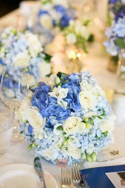 Blue flowers wedding table setting . Photo by www.meganaldridge.com.au