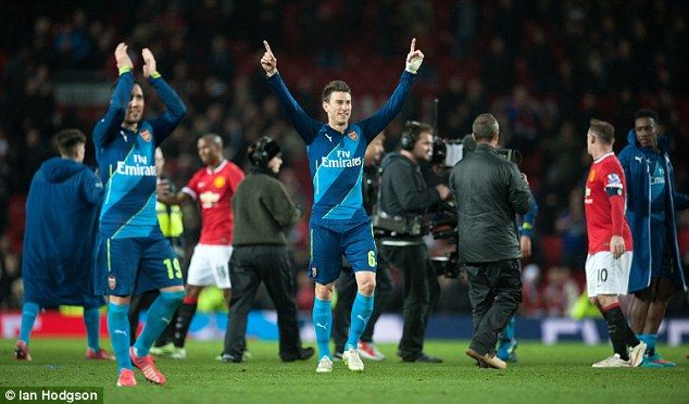 Arsenal duo Santi Cazorla (left) and Laurent Koscielny celebrate after the final whistle...
