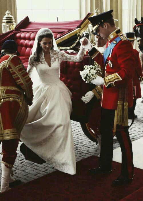 Prince William assisting his new bride Kate (Duke and Duchess of Cambridge) on their wedding day.