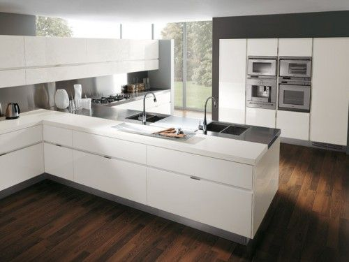 Contrast of white cabinets and dark flooring