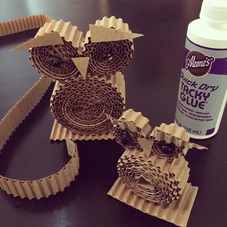 Corrugated Owls. Cut strips and roll them together to make some adorably simple owls. #owls #corrugated