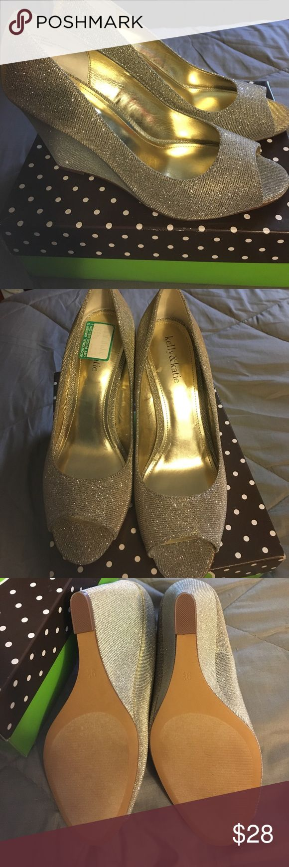 New in box, gold wedge heels Beautiful!!! Perfect for a special occasion!! New in box gold peep toe wedge Kelly & Katie Shoes Heels