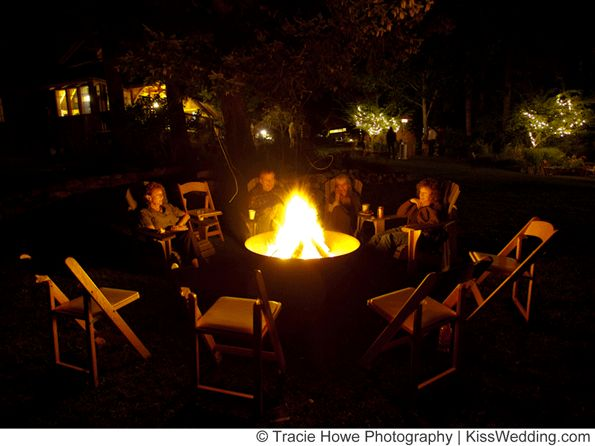 Bonfire for a backyard wedding will most likely keep some of your guest entertained & hold good conversation.