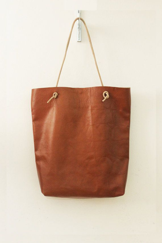 Leather tote bag handmade with care and thoughtfulness, since the designning up to last touches. Minimalist desgin with an elegant touch.  It can fill