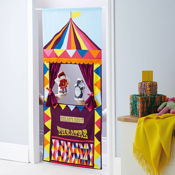 Personalised, handmade doorway puppet theatre.Roll up, roll up for the greatest show on earth! This funky fabric doorway theatre is designed exclusively by Wild Things, beautifully digitally printed here in the UK in a limited edition quantity. The theatre can be personalised with your child's/children's names, up to 15 characters (optional). Complete with a metal telescopic pole to neatly suspend from a doorway up to 100cm in width,Grips to your door frame with no need for any fittings. The…