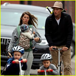 Gisele Bundchen walks with her dog Lua and her 10-month-old baby girl Vivian wrapped around her body while out with her family on Saturday a...