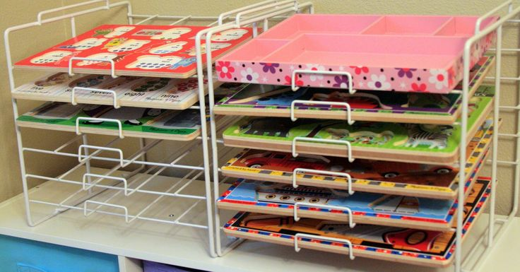 Use paper organizers for puzzles; from The Navy Stripe: Organizing Kids Toys