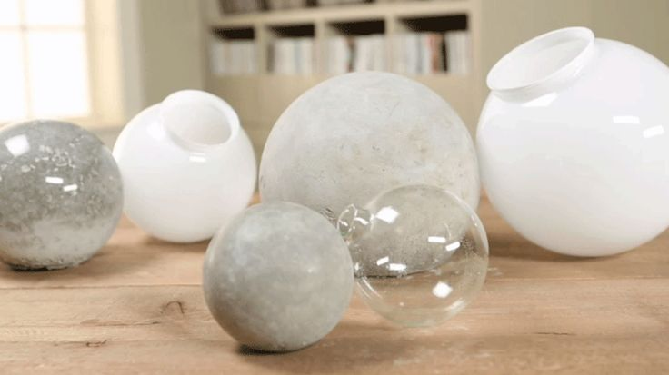 Make these inexpensive and fun concrete ball accents for your garden using surprising tools -- either a glass globe for a light fixture or a glass Christmas ornament.