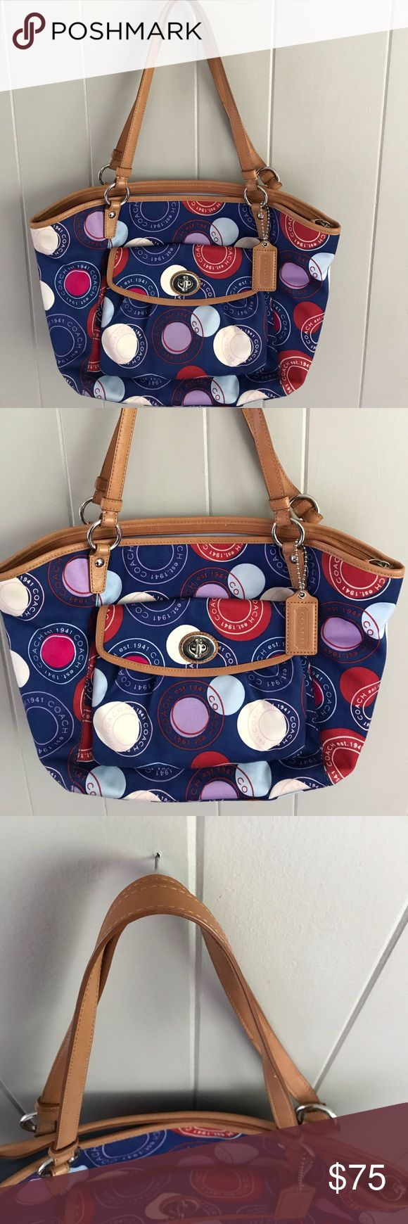 Coach multi color polka dot Tote Coachmulti color polka dot Tote/ shoulder bag. Good preowned condition with some pen marks on the lining. Leather trim is still in nice condition. Coach Bags Shoulder Bags