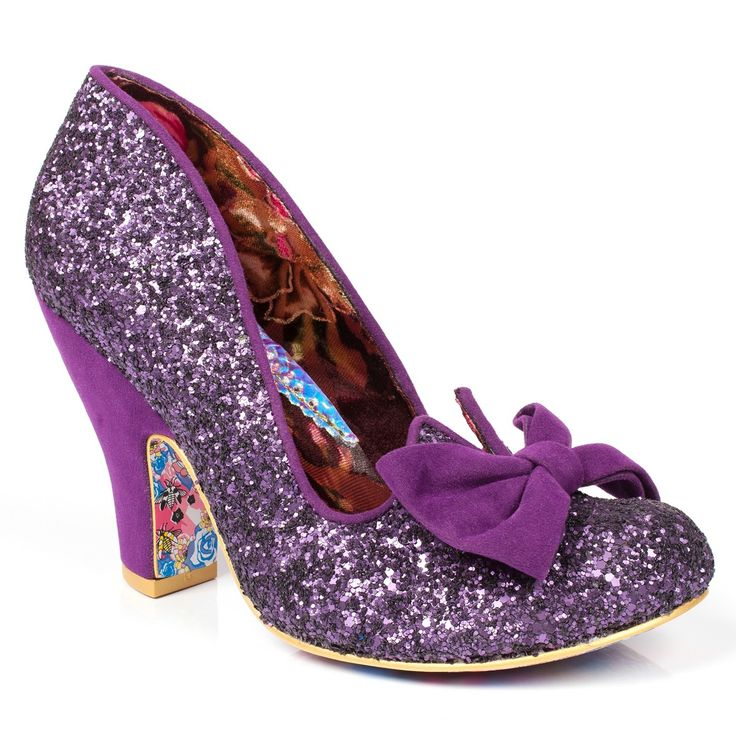 Bring a sprinkle of sparkle to your life with the fabulous Nick of Time. This popular style is back for another season, this time with dazzling purple glitter fabric and elegant faux suede bows. The perfect high heeled style for brides, bridesmaids and those of you who are looking for something extra special.