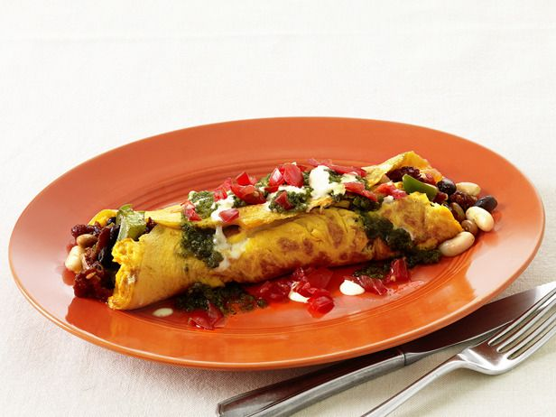 Sunny's Big Ole Tex-Mex Burrito Omelet. Colorful, hearty and satisfying, this spicy omelet is overflowing with sautéed veggies, Mexican chorizo and pepper-jack cheese. Sunny tops it off with a classic salsa verde featuring cilantro, tomatillos and jalapeno.