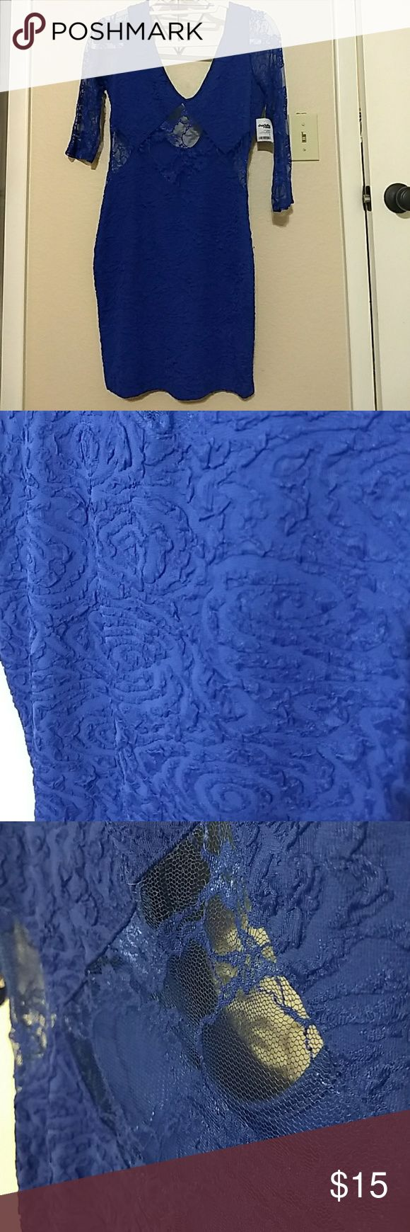 Blue night out dress *never worn* tags still attached Royal blue dress. She cut outs around waist with floral lace. Same on arms. 3/4 sleeve. Stretch material Charlotte Russe Dresses Mini