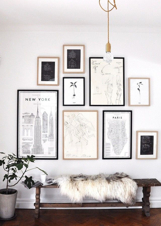 Black white and gold gallery wall above entry way bench