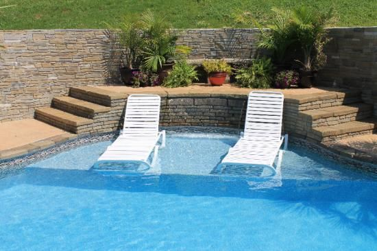 Inground pool with ledge for chairs consider a tanning for Pool design with tanning ledge