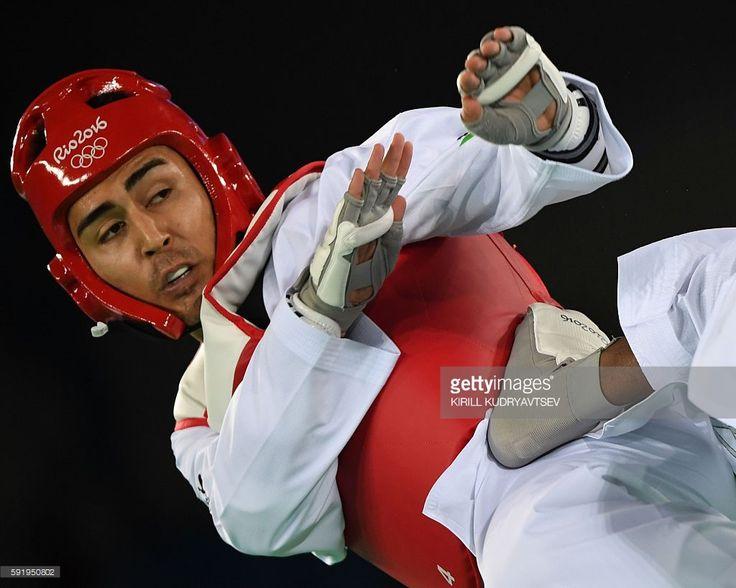 Great Britain's Lutalo Muhammad (R) kicks Australia's Hayder Shkara during their…