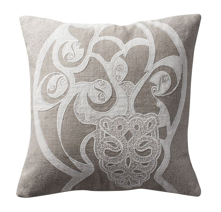 Intricate appliqué and embroidery to recreate the beauty of an ancient Celtic artefact | Aztaro cushion