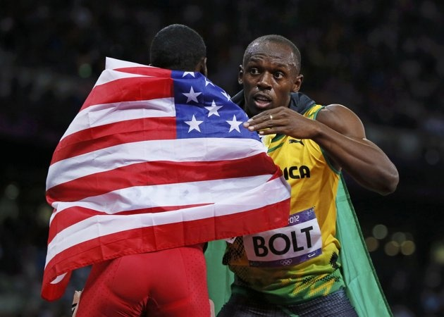 Jamaica's Usain Bolt (R) hugs Justin Gatlin of the U.S. after winning the men's 100m final with an Olympic record during the London 2012 Olympic Games at the Olympic Stadium August 5, 2012. Gatlin won the bronze medal in the race.