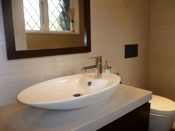 An interestingly shaped basin adds interest and a focal point to this powder room.