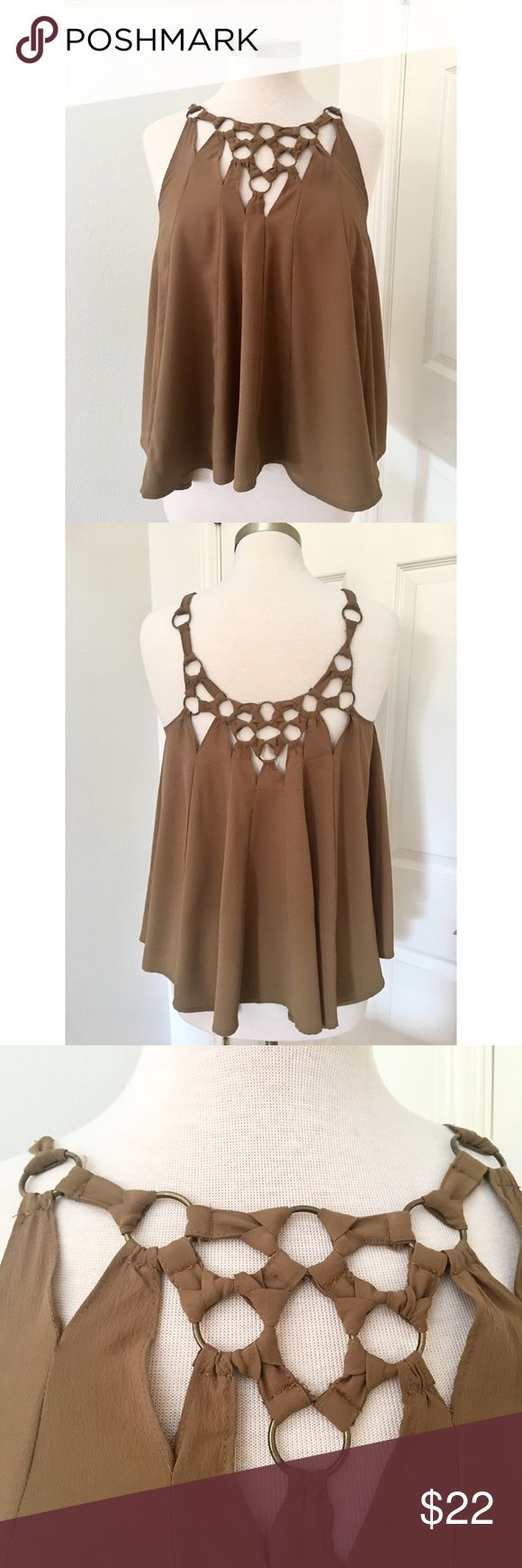Free People Swing Tank Size XS in Brown Funky swing style tank top by Free People. Strappy knotted detail with antique gold metal loops make this top beyond unique. Pretty brown taupe shade. Size XS. 100 % polyester. Free People Tops Tank Tops