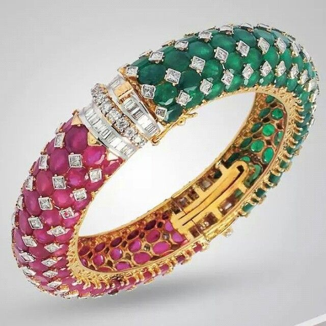 Gorgeous bracelet studded with rubies, emeralds and diamonds