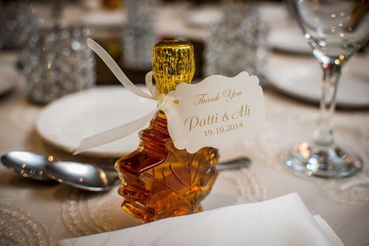 Their favours for their guests - Little Maple leaf bottles of Maple Syrup http://www.fusion-events.ca/