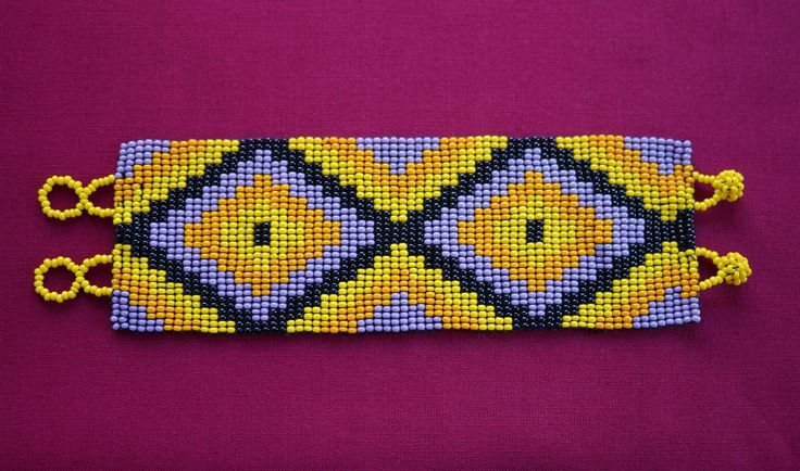MEXICAN RHOMBUS BEADED BRACELET - YELLOW & LILAC   ★ Mexican beaded bracelet, with a rhombus path in lilac, orange, yellow, and black. It's simple to wear; it just easily rolls over your hand and is very comfortable. ★ This beaded work is made by Mexican families. ★ You can combine it with various styles!