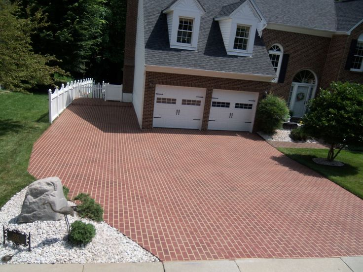 What a beautiful driveway! Check out how concrete driveway repair can turn old floors into a work of art. Call us now at (636) 256-6733 for more info on designs and costs.
