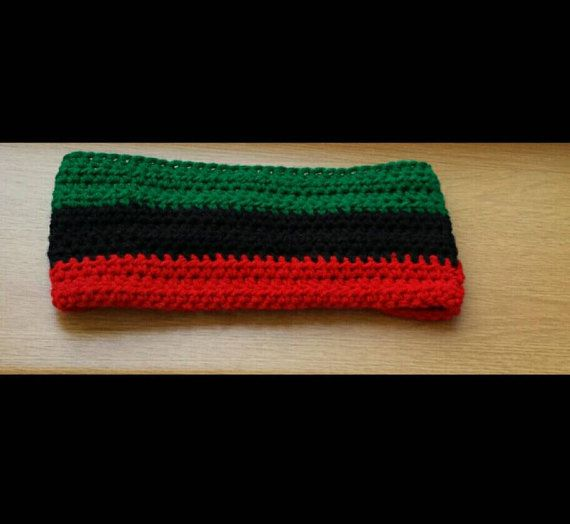 Ethic style wide headband in bold red, green and black colours. This is great for keeping back big hair, dreadlocks or covering those ears to keep them warm. This has been handmade in crochet and still has some stretch to it and suitable for average adult head size. There is a button as demonstrated in the photos to keep it secure around the head. Its stylish, unique and what better then handmade ? Measurements Flat on table inside un stretched Full length around with button done up - 21…