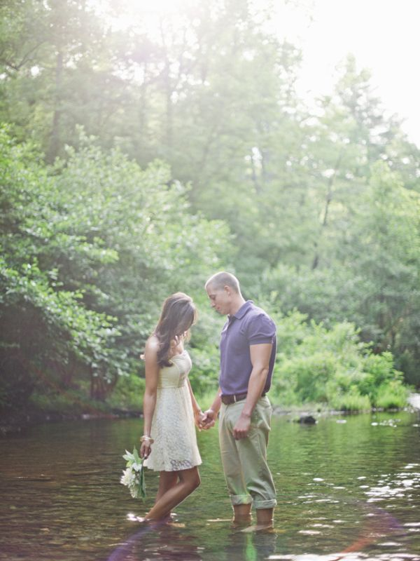 Jeremy Harwell, camping engagement session, outdoors, tents, river, trees, fire, bonfire, ruffled dress, spring enagement session ideas, summer engagement session ideas