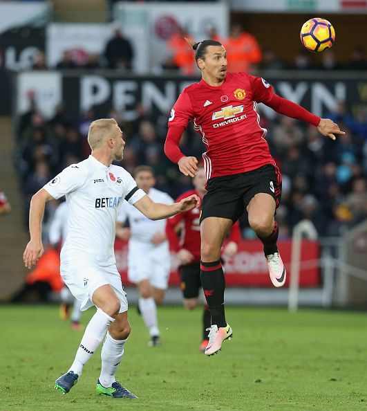 Zlatan Ibrahimovic of Manchester United in action with Mike van der Hoorn of Swansea City during the Premier League match between Swansea City and...