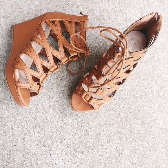 """✨RESTOCK✨✨Tan Lace Up Wedges Make your weekend memorable in these trendy women's wedge heel lace up gladiator style sandals.These sandals with back zipper,padded insole,stiching details will match well with both jeans and dresses.  Material: Faux Leather  Measurements:  PlatformHeight: 0.15"""" Platform Heel Height: 3.25"""" Heel Boots Circumference: 10"""" Circumference Shaft Heights: 3.5"""" ✨ Shoes Wedges"""