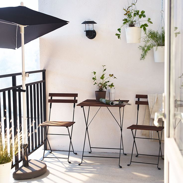 outdoor area hanging pot plants  side umbrella & half moon base - good for limited space on small balcony