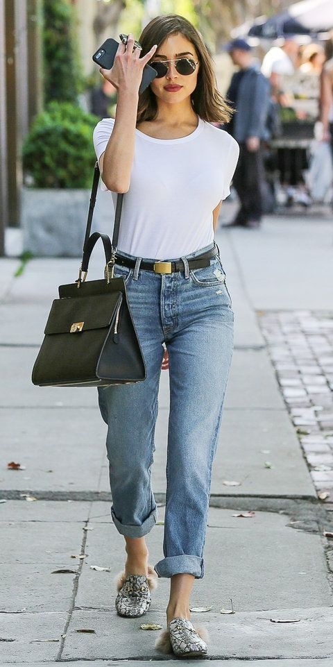 "Olivia Culpo stepped out in perfectly cuffed denim and a plain white tee to give the effortless ""girl next door"" vibe. She paired her denim with a classic black belt and added a touch of cool with Gucci's snakeskin fur-trim loafers."